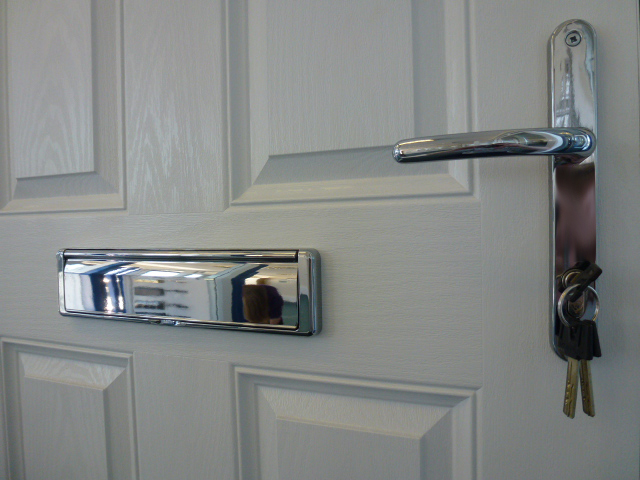 Internal side of composite door with chrome door furniture