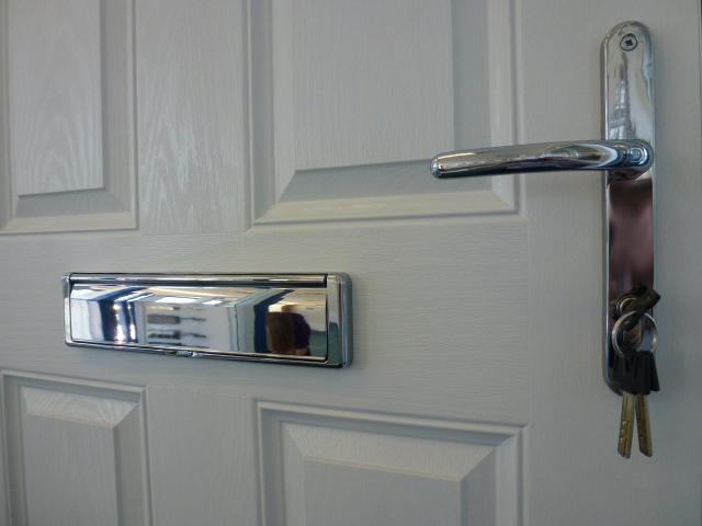 Internal side of composite door with chrome door furniture
